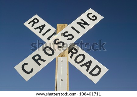 Railroad crossing sign and intersection in Mojave Desert of Southern California - stock photo