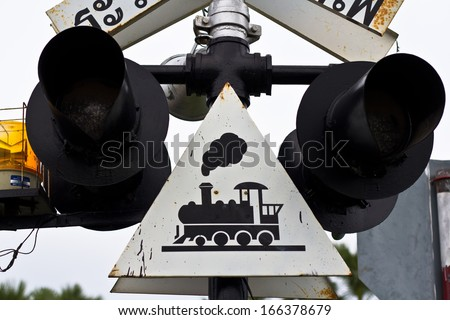 Railroad Crossing sign and warning in Thailand - stock photo
