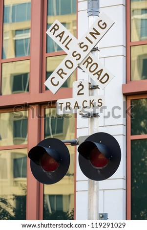 Railroad crossing sign by new offices for Department of Transportation in Washington DC - stock photo