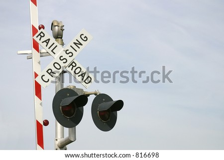 Railroad crossing sign with two warning lights and the red & white road barrier raised. Photo ID: RailroadSign00001 - stock photo