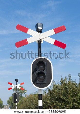 railroad crossing sign with warning lights - stock photo