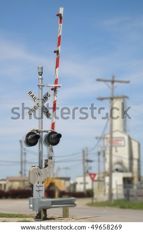 Railroad crossing signal. - stock photo