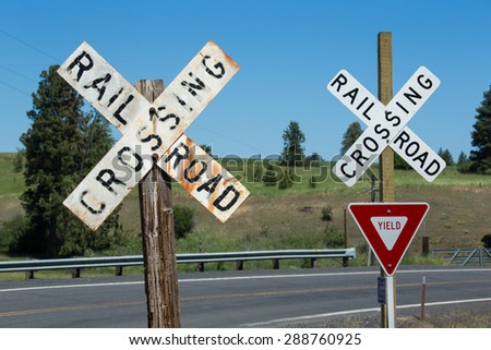 Railroad crossing signs - stock photo