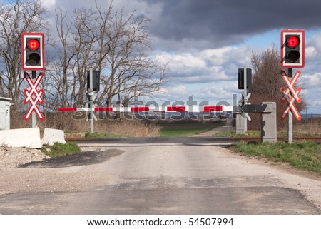 Railroad crossing with barriers and security system