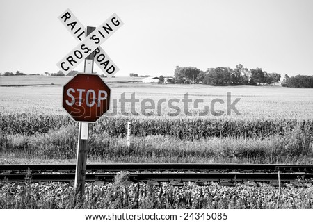 Railroad crossing with stop warning sign - stock photo