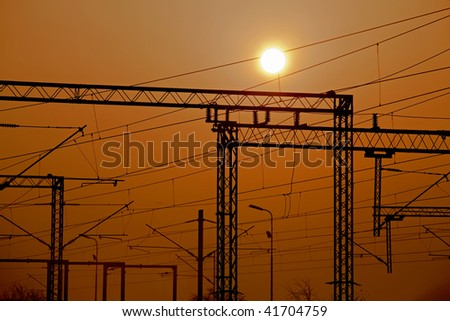 Railroad electric pylons on sunset - stock photo