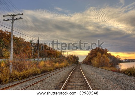 Railroad in a fall sunset - stock photo