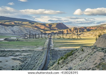 railroad in in the valley of upper Colorado RIver between State Bridge and Dotsero, Colorado, springtime scenery - stock photo