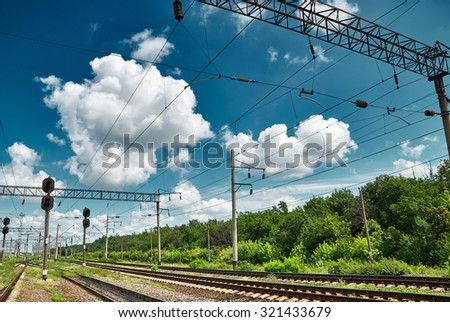 railroad infrastructure with traffic lights - stock photo