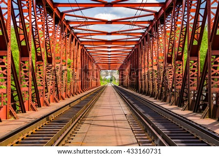 Railroad on a red bridge in summer day