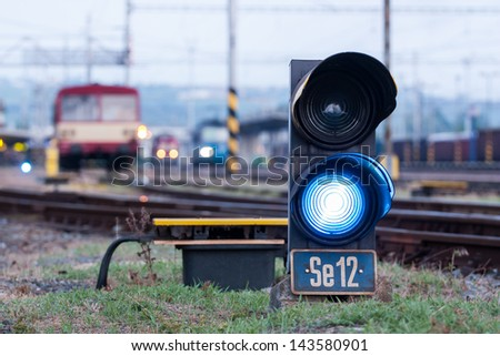Railroad. Shunting traffic lights blue signal - stock photo