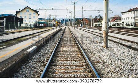 Railroad station,  railroad tracks and a cargo platform for trains - stock photo