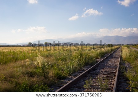 Railroad sunset, mountains and blue sky.