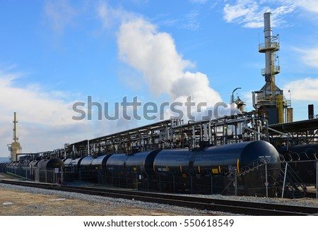 Railroad tank cars are parked at a California refinery, ready to take on cargo.