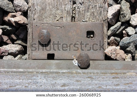 Railroad tie and spike close up - stock photo