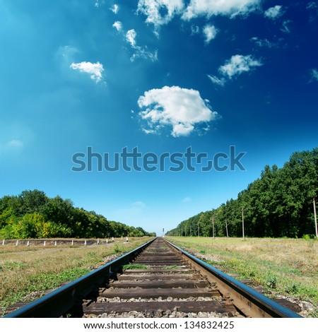 railroad to green horizon - stock photo