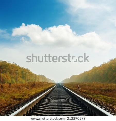 railroad to horizon in autumn - stock photo