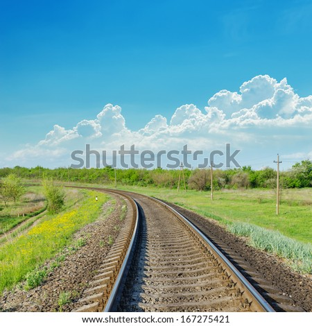 railroad to horizon in green landscape