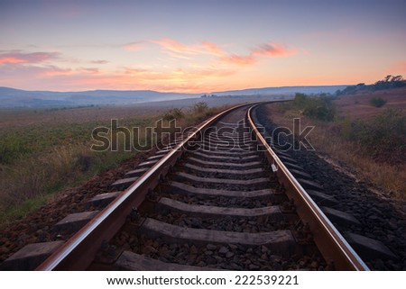 railroad to red sunset - stock photo