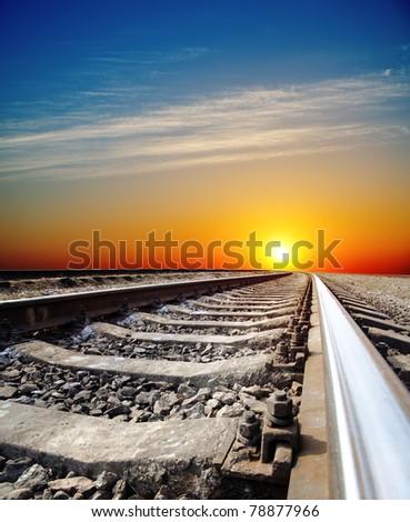 railroad to sunset - stock photo