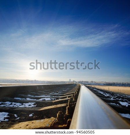railroad to sunset. winter time - stock photo