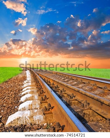 railroad to the sunset - stock photo