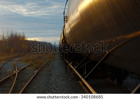 railroad track and wagon train oil container