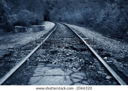 railroad track in low key country setting