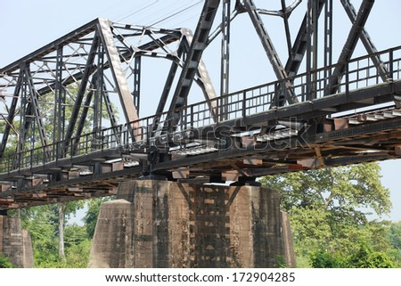Railroad track on steel bridge and concrete foundation supporting  - stock photo