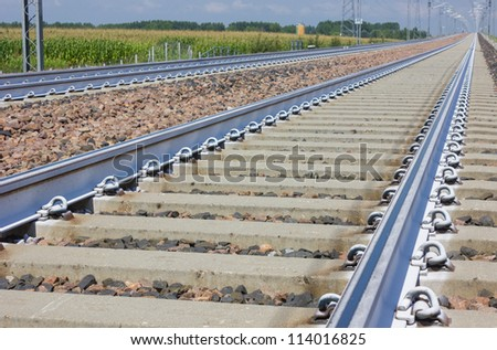 Railroad track vanishing into the distance. - stock photo