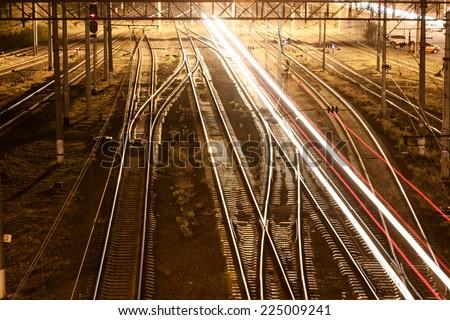 Railroad Tracks at a Major Train Station at Sunset - stock photo