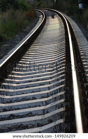 Railroad tracks at sunset - stock photo