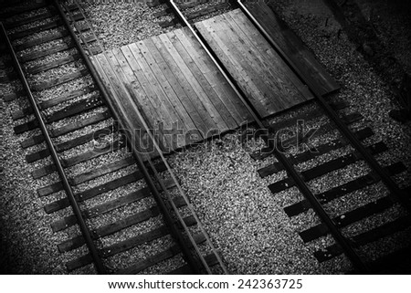 Railroad Tracks Closeup From Above. Black and White Railroad Theme. - stock photo