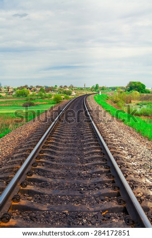 railroad tracks going into the distance in the summer