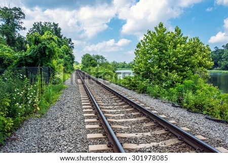 Railroad tracks in Central New Jersey along the Delaware River. - stock photo