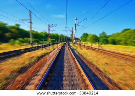 Railroad tracks in motion - stock photo