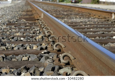 railroad tracks in perspective - stock photo