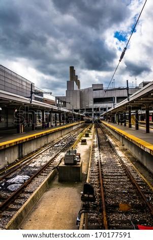 Railroad tracks in the South Station, Boston, Massachusetts. - stock photo