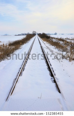 Railroad tracks in Winter - stock photo
