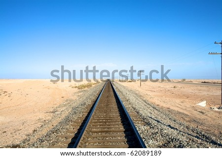 Railroad Tracks into Horizon - stock photo
