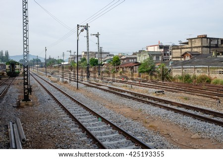 Railroad tracks line of a Public Thai Train Railway, train railway scene from passenger, go travel and journey by train - stock photo