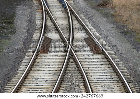 railroad tracks with railroad switch, two paths come together - stock photo