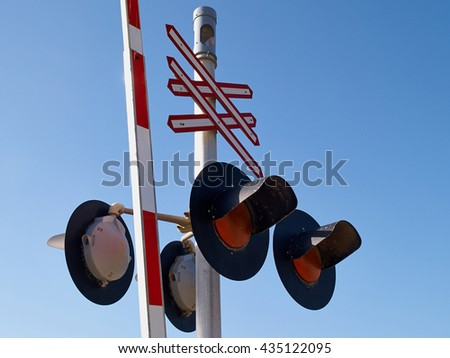 Railroad train crossing sign signal light with clear blue sky background     - stock photo
