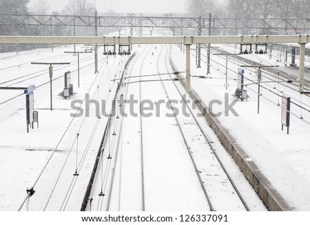 railroad with snow - stock photo