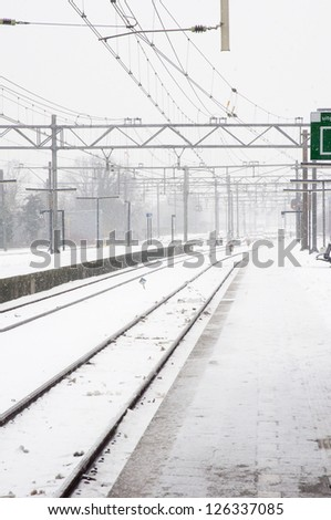 railroad with snow in the winter - stock photo
