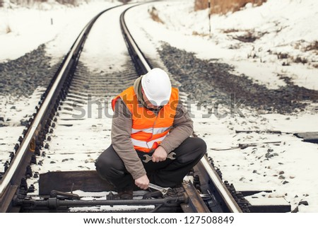 Railroad worker with adjustable wrench in the hand - stock photo