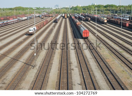 Railroad Yard Terminal with New Automobiles for Export - stock photo