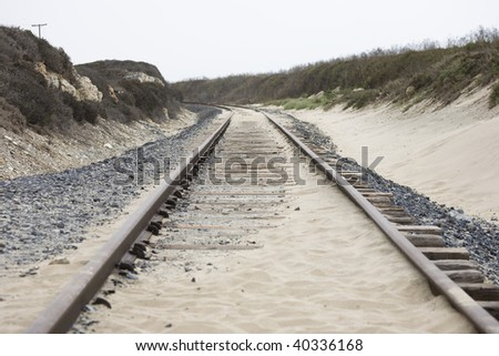 rails in the dunes in California, USA - stock photo