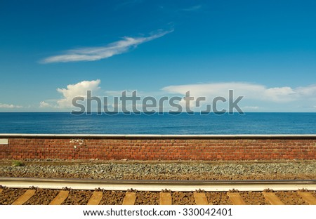 Rails on the sea background. Railway station of Manarola, typical town of Cinque Terre - Italy - stock photo