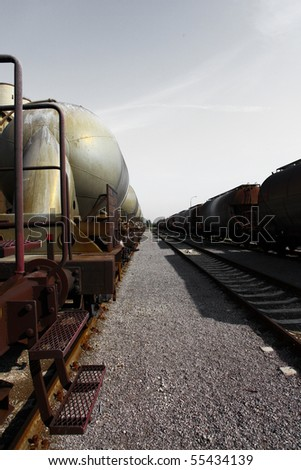 Railway and wagons and grey sky above